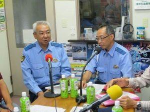 深川警察署交通課の高野さん、留萌警察署交通課の奈須野さんの写真