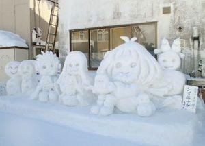 本田洋服店前雪像の写真